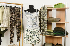 Wardrobe with camo pattern clothes and accessories. Royalty Free Stock Images