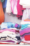 Wardrobe with child clothes Stock Photo