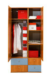 Wardrobe with clothes Stock Images