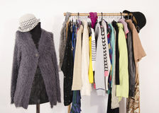 Wardrobe with clothes arranged on hangers and a winter outfit on a mannequin. Royalty Free Stock Photography