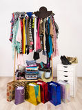 Wardrobe with clothes and shopping bags. Stock Photos