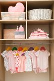 Wardrobe with cute baby clothes. And home stuff royalty free stock images