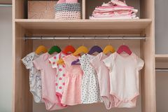Wardrobe with cute baby clothes. And home stuff stock images