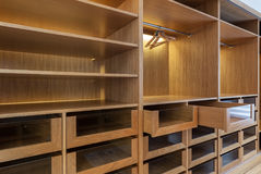 Wardrobe with empty drawers and shelves. Royalty Free Stock Images