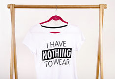 Wardrobe with an empty rack with noting to wear t-shirt. Stock Photos