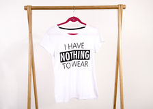 Wardrobe with an empty rack with noting to wear t-shirt. Stock Photo