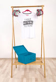 Wardrobe with an empty rack with noting to wear t-shirt. Royalty Free Stock Images