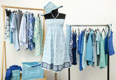 Wardrobe full of all shades of blue clothes and accessories. Stock Photos