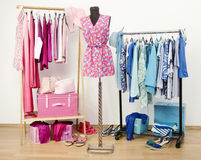 Wardrobe full of all shades of blue and pink clothes, shoes and accessories. Stock Image