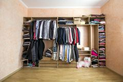 Wardrobe full of different men and woman clothes Stock Photo