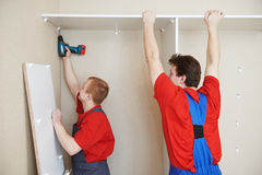 Wardrobe joiners at installation work Royalty Free Stock Photography