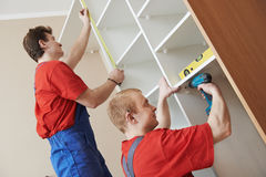 Wardrobe joiners at installation work Stock Photography