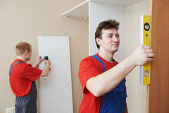 Wardrobe joiners at installation work Stock Photo