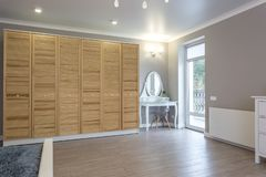 Wardrobe made of thin wooden planks in apartment room. ecological furniture stock photography