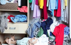 Wardrobe with messy clothes,. Closeup stock photography