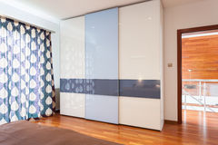 Wardrobe in modern bedroom Stock Images