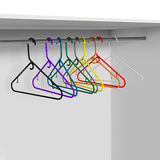 Wardrobe with plastic clothes hangers Royalty Free Stock Images