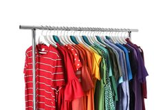 Wardrobe rack with different colorful clothes. On white background royalty free stock images