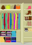 Wardrobe room full of woman's cloths Stock Photos