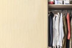 Wardrobe with a shelf, boxes stock image