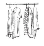 Wardrobe sketch. Clothes on the hangers. Royalty Free Stock Photos