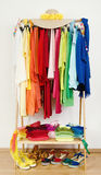 Wardrobe with summer clothes nicely arranged by colors. Royalty Free Stock Photography