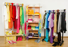 Wardrobe with summer clothes nicely arranged. Stock Photos