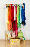 Wardrobe with summer clothes nicely arranged. Royalty Free Stock Photography