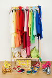 Wardrobe with summer clothes nicely arranged. Royalty Free Stock Images