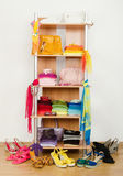 Wardrobe with summer clothes nicely arranged. Stock Image