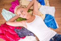 Wardrobe. Top view of young woman is lying on the clothes Royalty Free Stock Image
