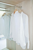 Wardrobe white shirt Stock Image