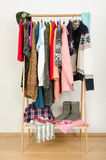 Wardrobe with winter clothes nicely arranged. Stock Photos