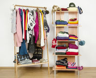 Wardrobe with winter clothes nicely arranged. Stock Image