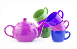 Ware set for tea, coffee with a pink teapot. Set of multi-colored ware for tea, coffee with a pink teapot. Teapot, coffee pot and six cups, Tea ceremony. It is Stock Image