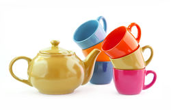 Ware set for tea, coffee with a yellow teapot. Set of multi-colored ware for tea, coffee with a yellow teapot. Teapot, coffee pot and six cups, Tea ceremony. It Royalty Free Stock Photography