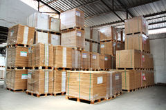 Warehouse. Stack of product on pallets in warehouse Stock Image