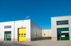 Warehouse. Industrial warehouse with green and yellow roller doors Royalty Free Stock Photo