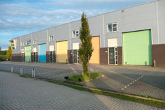 Warehouse. Industrial warehouse with roller doors in soft pastel tints Stock Photos