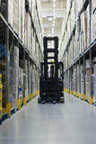 Warehouse. With fork lift operating royalty free stock images