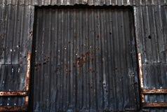 Warehouse. Rusty old metallic warehouse door Stock Images