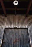 Warehouse. Rusty old metallic warehouse door Royalty Free Stock Photos