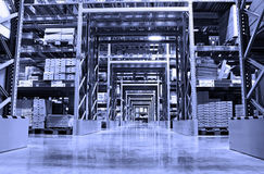 Warehouse. A spacious warehouse in blue light stock photography