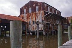 Warehouse abandonado por el agua Imágenes de archivo libres de regalías