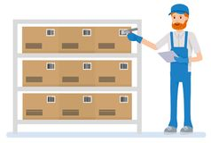 Warehouse arbetarscanningbarcoden på asken i ett stort lager Fotografering för Bildbyråer