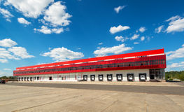 Warehouse on a background of blue sky Stock Photos