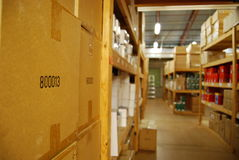 Warehouse Boxes. A bunch of boxes sitting in a warehouse Royalty Free Stock Photo