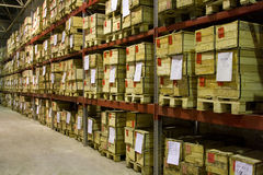 Warehouse with boxes. Industrial warehouse with plenty of boxes Royalty Free Stock Image