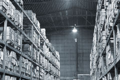 Warehouse with boxes. Industrial warehouse with plenty of boxes. Black and white photo Stock Photo