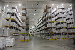 Warehouse with boxes. And racking Royalty Free Stock Photo